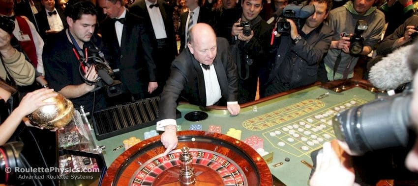 Dealer spinning roulette wheel