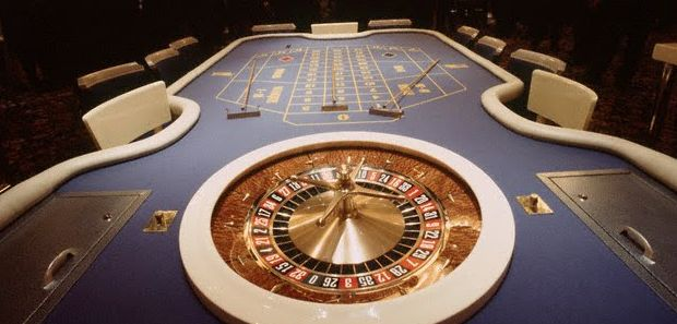 Roulette wheel with table at the end.