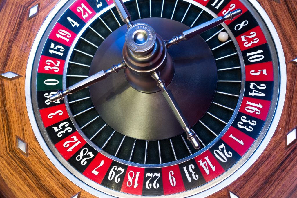 Roulette ball lands on number 8. Be aware of scams.