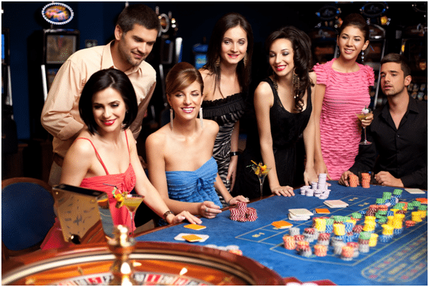 Group of roulette players around wheel.