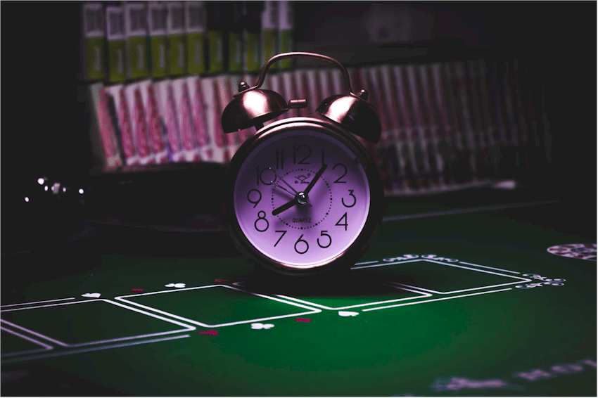 Clock on gambling table.