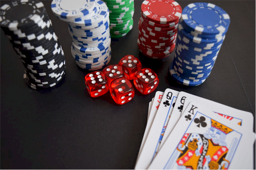 Stack of cards and casino chips.